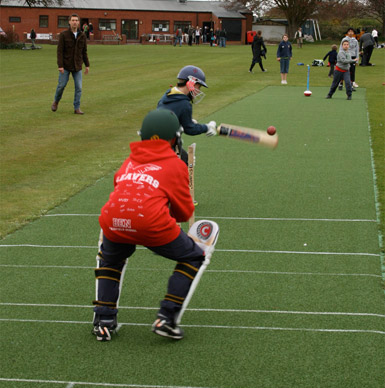 Cleeve CC youth Player using new non-turf cricket net facility