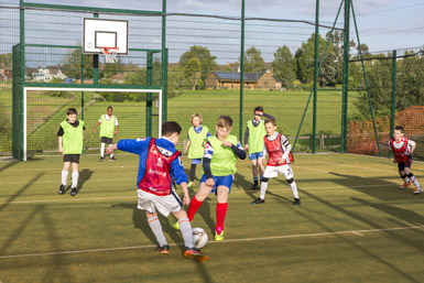 Students playing football on MUGA at Great Brickhill