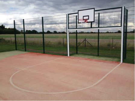 MUGA Pitch at Stisted Primary Academy with Basket Ball hoop and goal area.