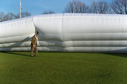Bio-Cell Hybrid Climate Cover Pitch Protection, Inflated with Human for Scale, side angle