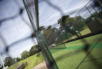 Through the net photo of non-turf cricket practice system