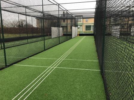 White coaching lines artificial cricket practice nets