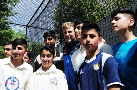 Joe Root playing with young fans at the Joe Root at the Official Launch of Bradford Park Avenue total-play practice nets